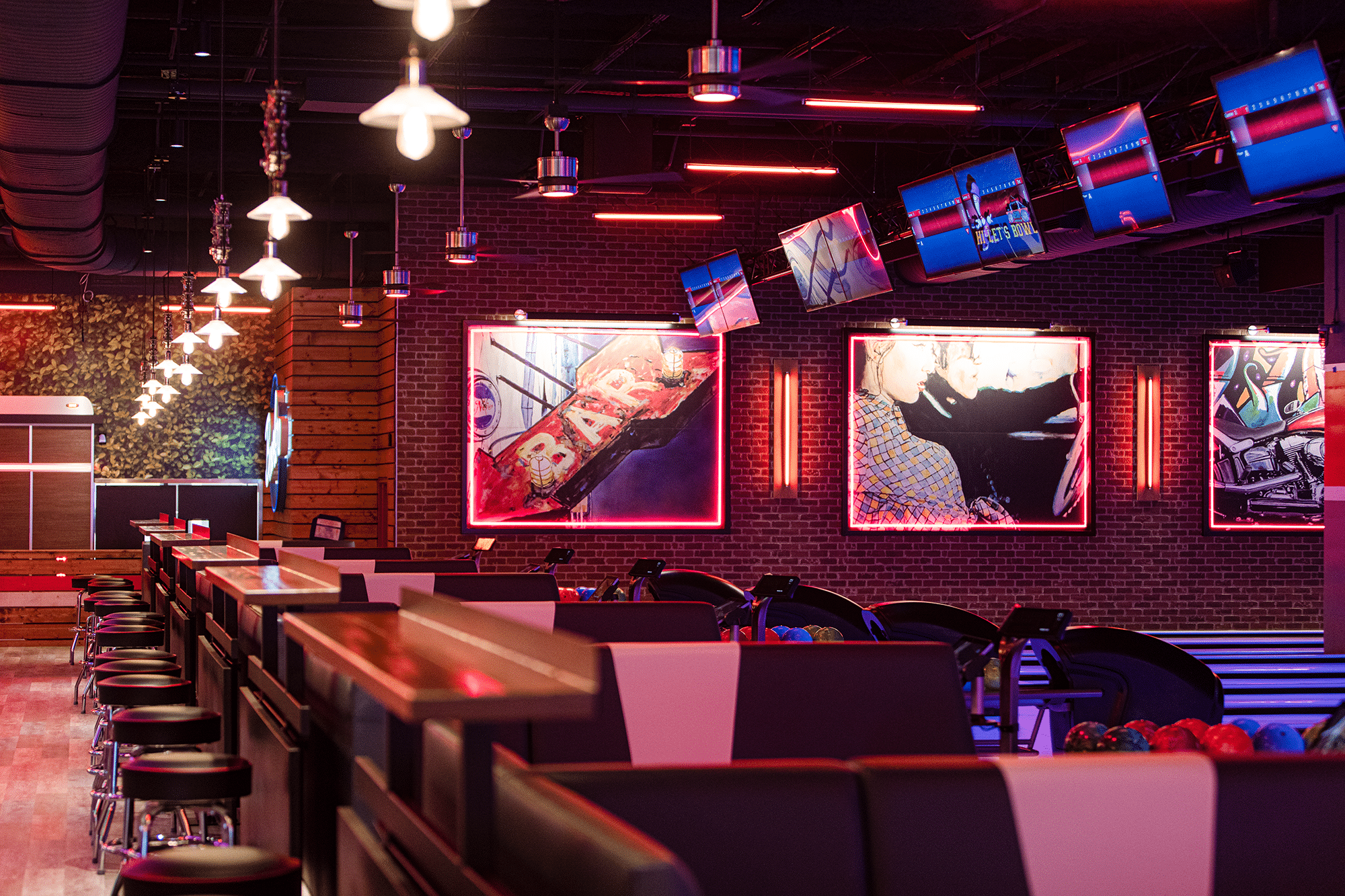 Seating with artwork and overhead tvs.