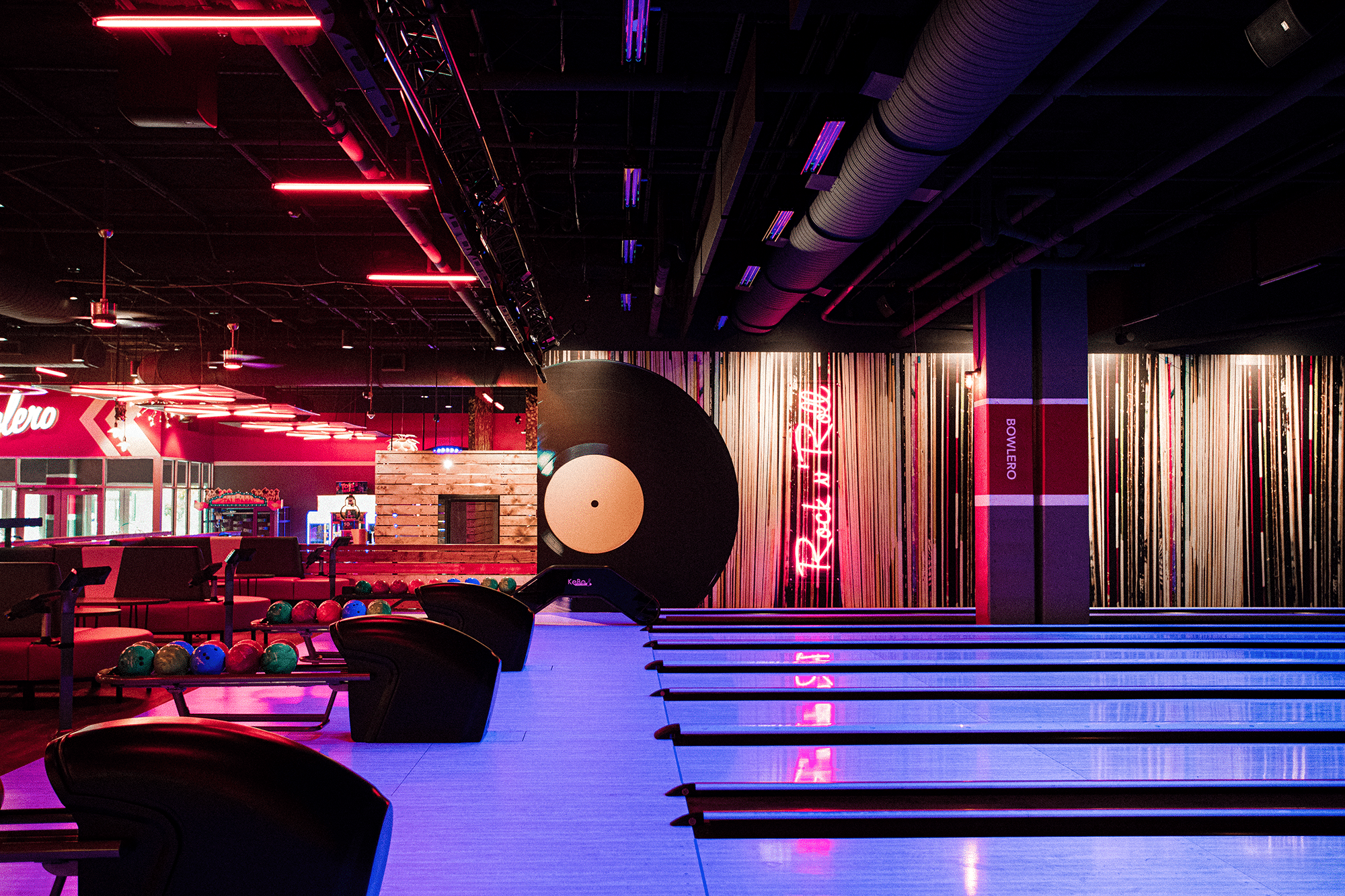 Bowling lanes with red lighting.